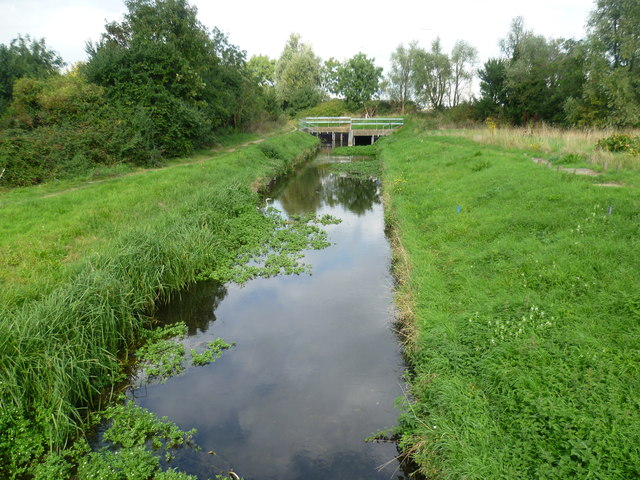 The Longford River emerges from under Southern Perimeter Road
