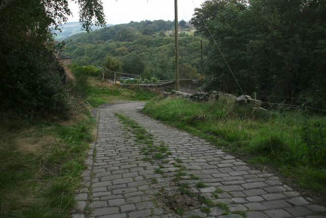 Nether Moor Road: cobbled track leading to bridge over disused railway