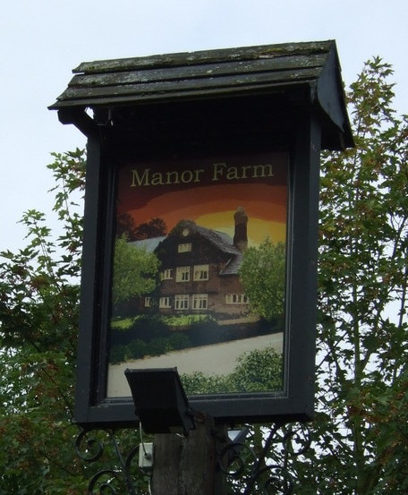 SIgn for the Manor Farm pub, Rainhill