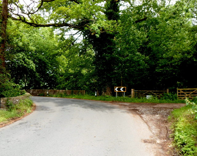 Sharp bend in the B4558 on the approach to Fro Bridge