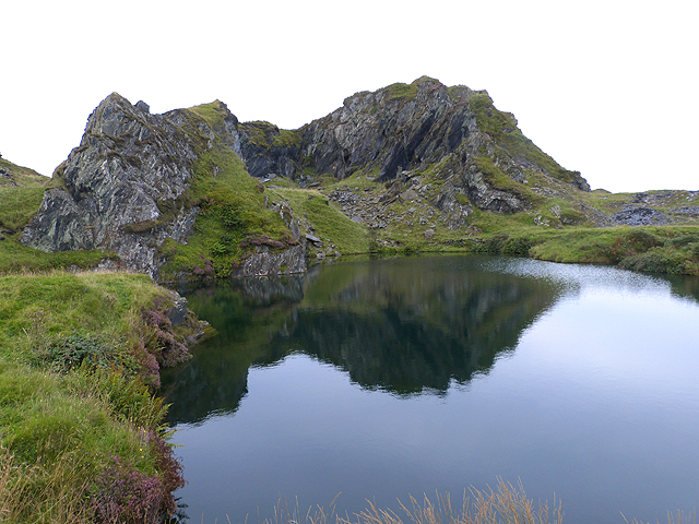 Reflections in a flooded quarry at Cuan Point