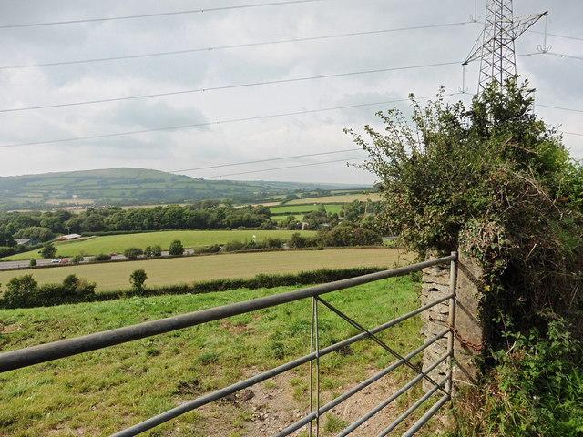 Scene across farmland, with pylon