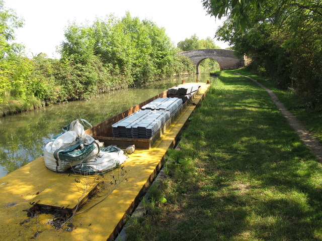 Narrowboat with cargo of canal bank piling materials