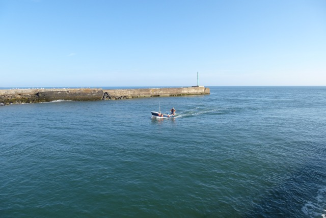 Boat entering the breakwaters