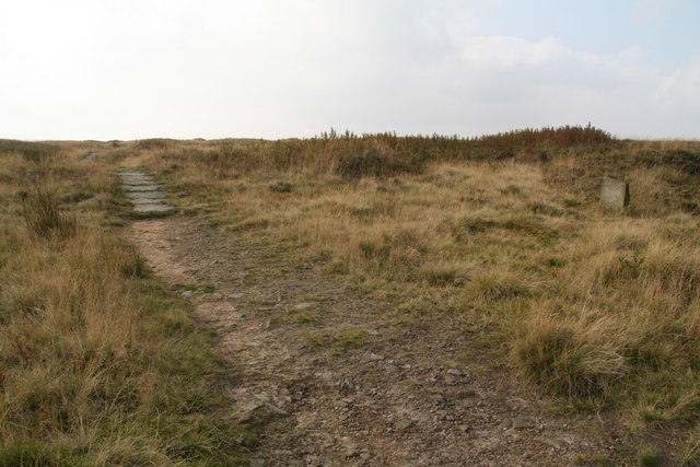 Beginning of a paved section of the Pennine Way north of the Black Hill trig point