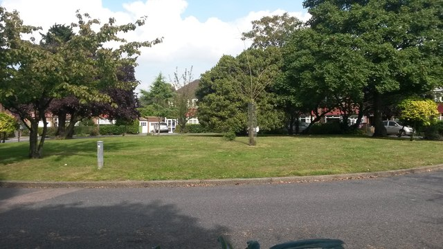 Green roundabout in the leafy Shrewsbury Park Estate