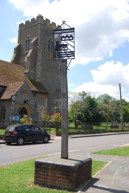 Village sign and church, Tattingstone