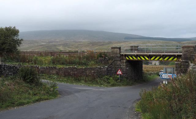 Railway bridge over minor road at Garsdale Station
