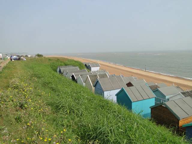 Across the top of the beach huts to the sea
