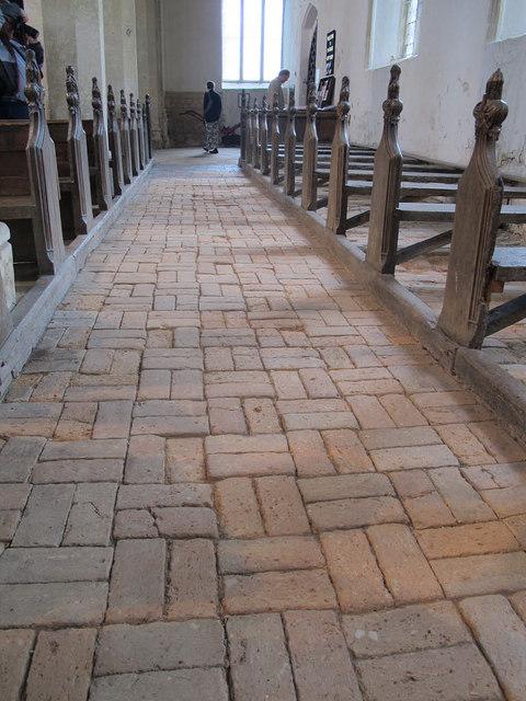 Cawston, St Agnes: brick floor