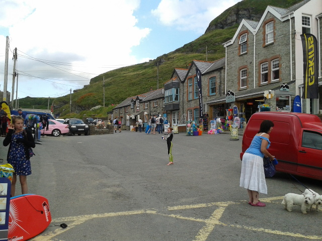 Shops, houses, cars, people, dogs at Trebarwith Strand