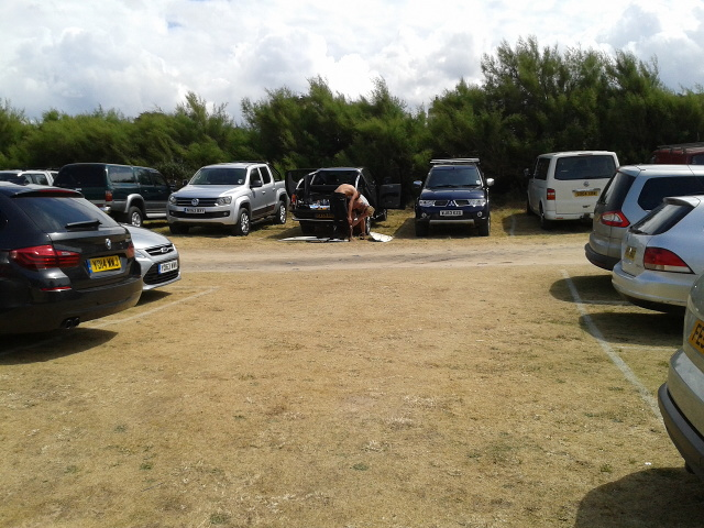 Parking in a field converted to a car park at Constantine Bay