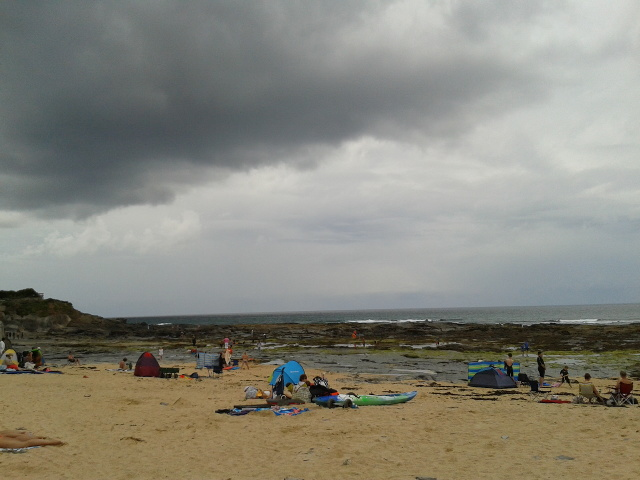 On the beach, under a cloud, at Constantine Bay