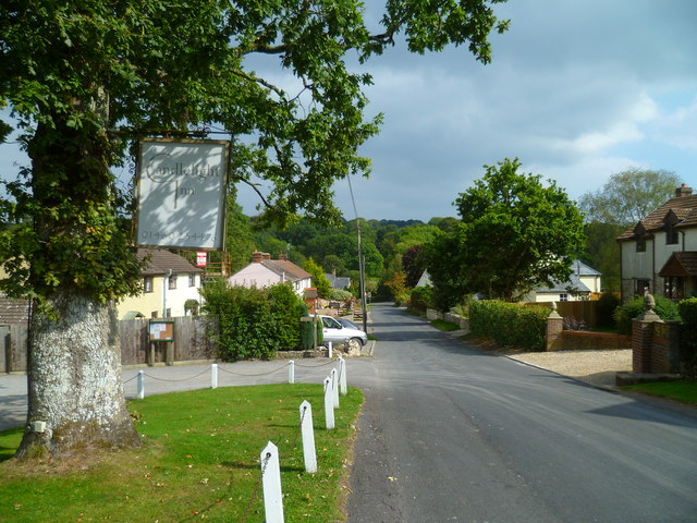 Looking east on main road in Bishopswood past footpath on left