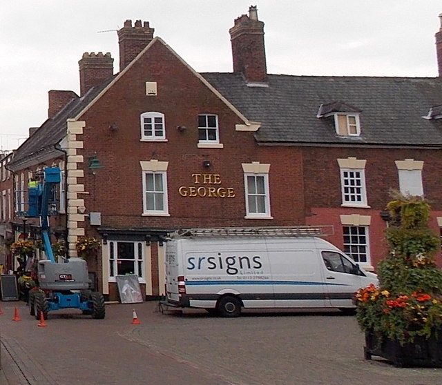 Removing the pub name sign from The George in Oswestry