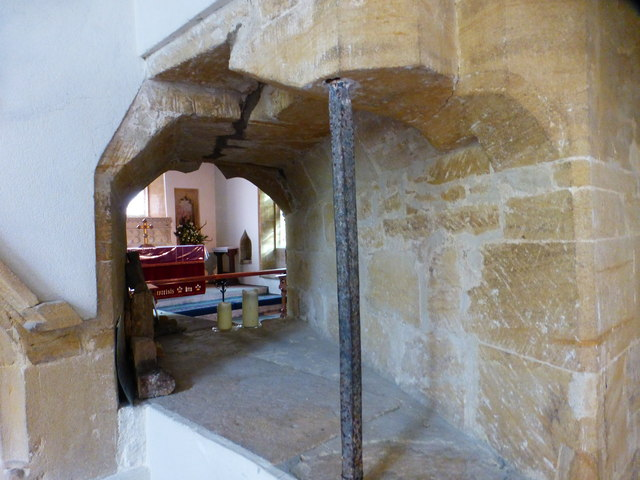Looking through the squint on the north transept of Barrington church
