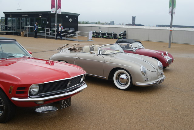 View of a 1973 Ford Mustang Sportsroof, a Porsche 356A Cabriolet and Austin Healy at the entrance to the OIympic Park