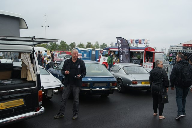 View of an E-type Jaguar, Jensen FF and Lotus in the Classic Car Boot Sale