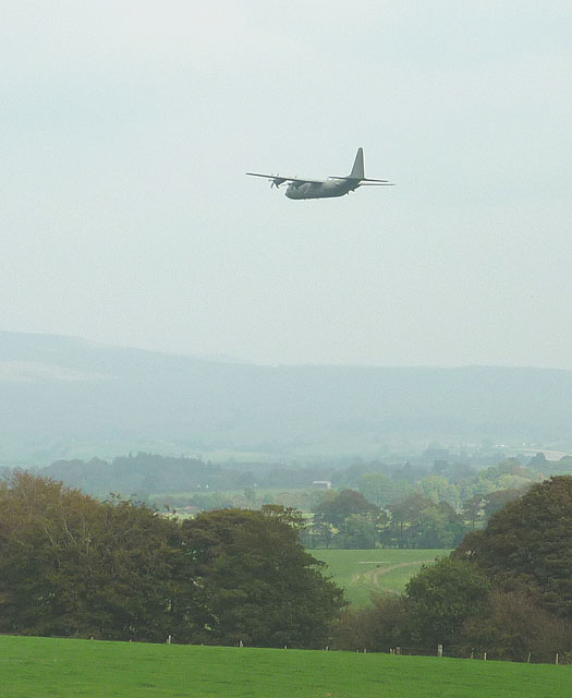 Military transport plane flying up the Lune Valley