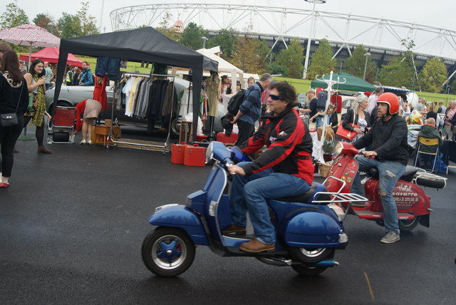 View of a Vespa arriving from the Ace Cafe