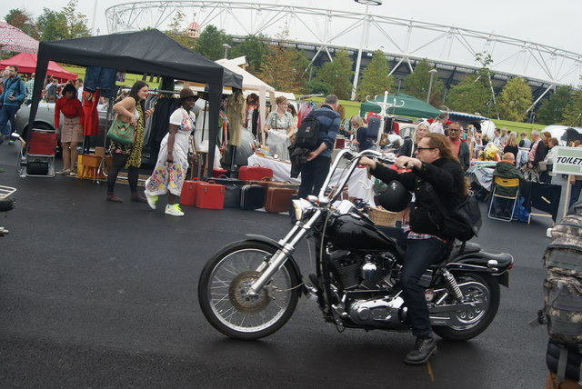 View of a Harley-Davidson arriving at the Classic Car Boot Sale from Ace Cafe