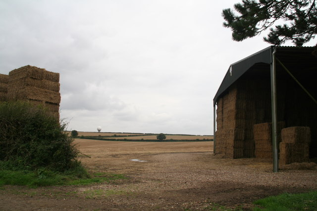View between straw stacks, opposite Acre House