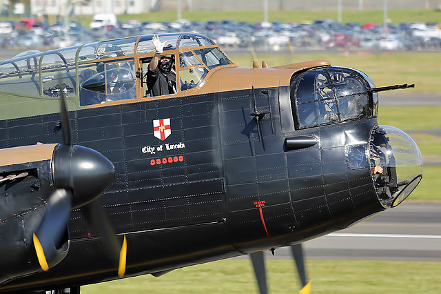 A wave from the cockpit of the City of Lincoln RAF Lancaster