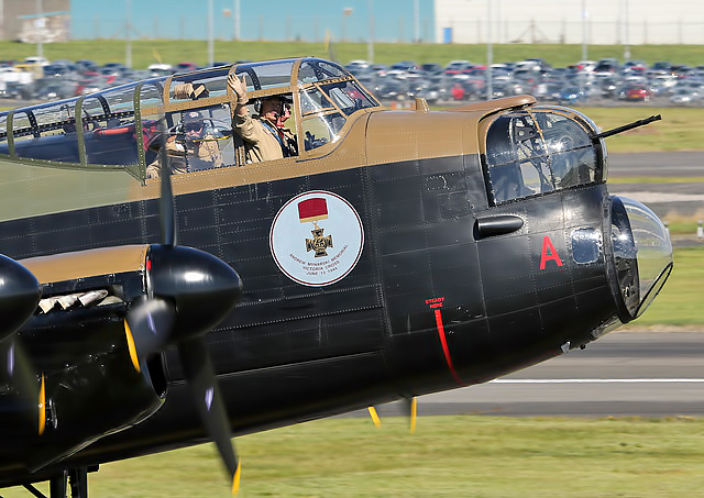 A wave from the cockpit of the Canadian Lancaster Vera