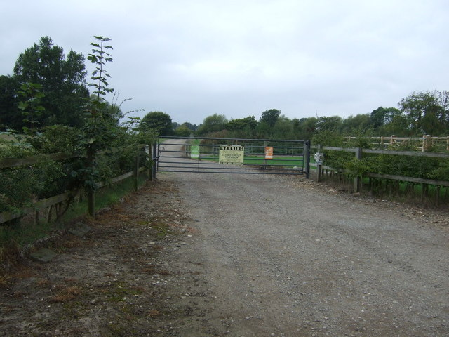 Gated farm track off Kirton Road