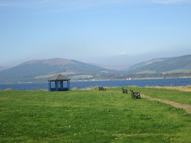 Waterside grassland and a shelter at Ardbeg Point