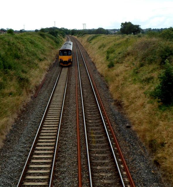Diesel locomotive heads away from a railway bridge, Flax Bourton