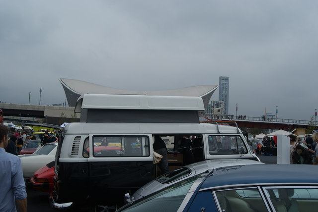 View of the Aquatics Centre lining up with the roof of a camper van
