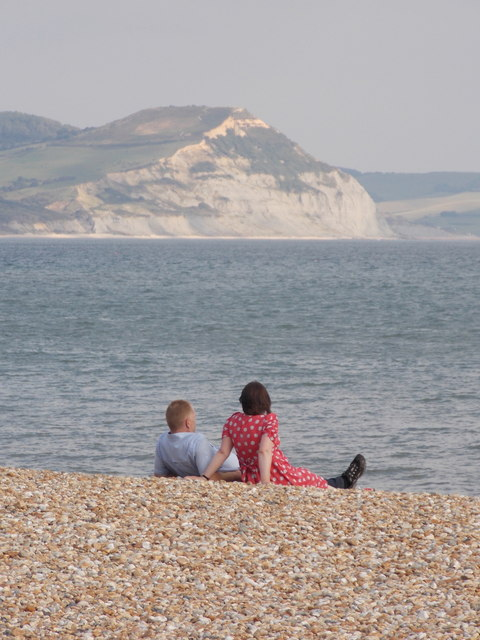 Lyme Regis: a couple enjoying the beach and the view