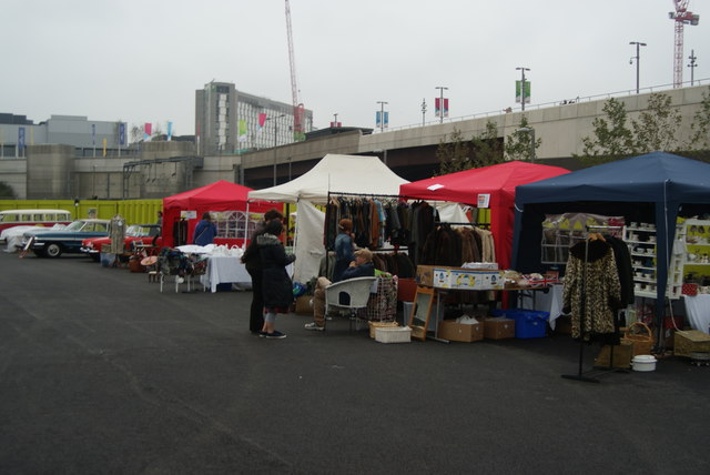View of a row of stalls in the Classic Car Boot Sale lining up with the walkway into the Olympic Park