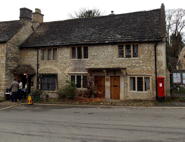 Cottages and postbox opposite the Butter Cross in Castle Combe