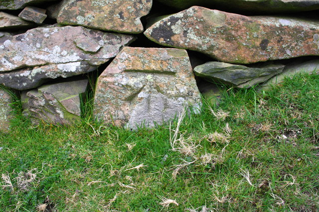 Benchmark on wall stone at track junction, Murthwaite Rigg