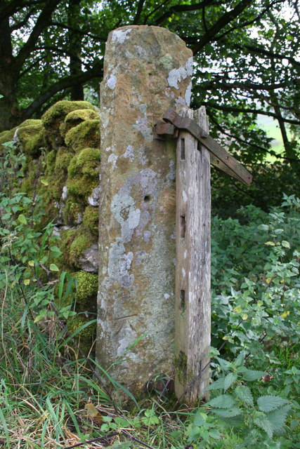 Benchmark on gatepost beside A683 at Sandbed