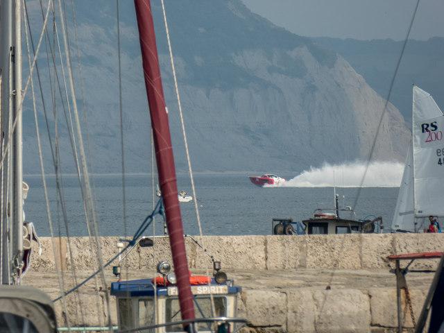 Speed Boat approaches Lyme Regis, Dorset