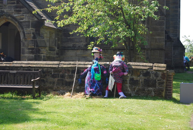 Scarecrows by the church wall