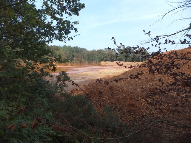 Flooded quarry with sand settling