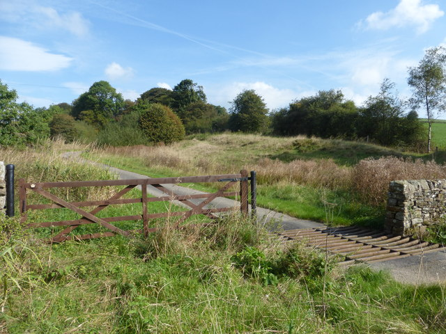Gate and cattle grid on the track to Bullclough