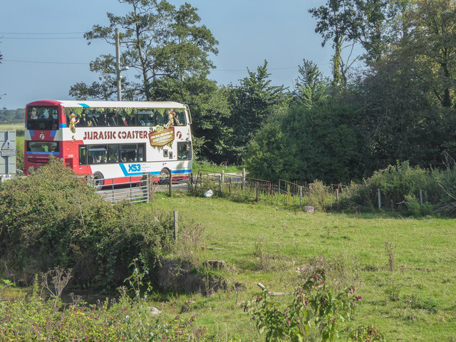 Jurassic Coast Bus waiting at Level Crossing, Devon