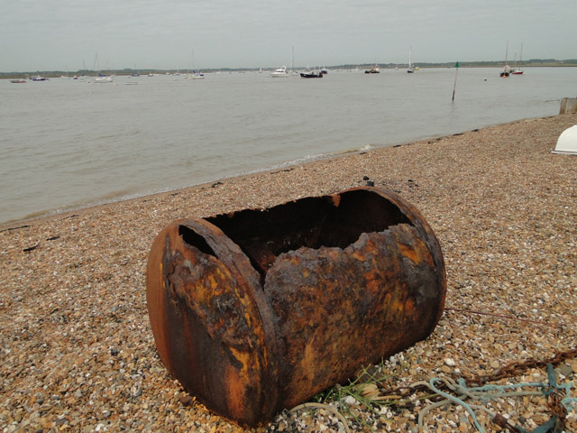 Rusted buoy on the foreshore