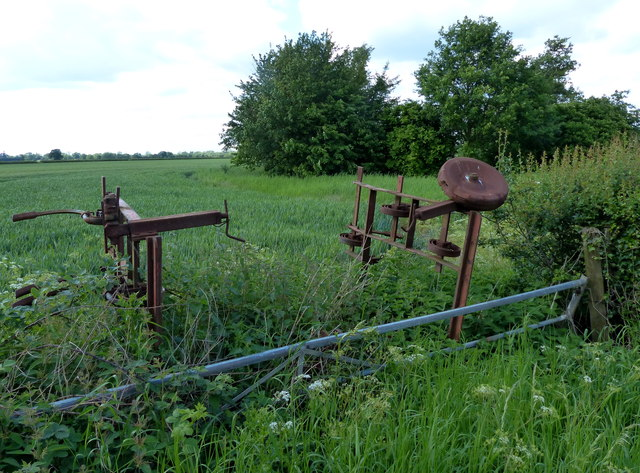 Old farm machinery next to the B4065 Leicester Road