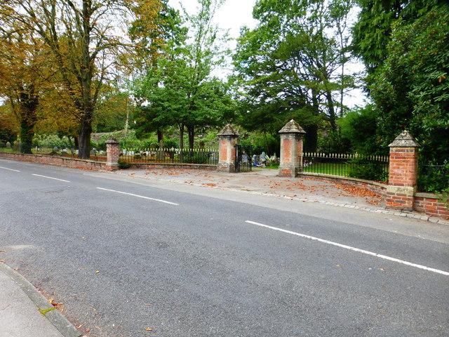 Gateway to narrow part of graveyard between road and railway