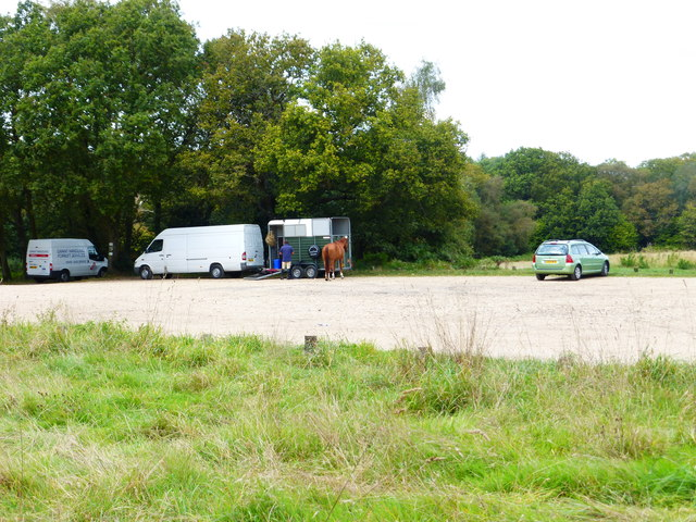 Parking area with vehicles and horse off Bourley Road