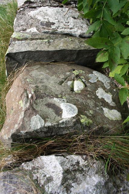 Benchmark on parapet of bridge over dry streambed