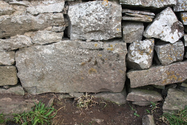 Benchmark on Barn beside A685 below Petty Brow
