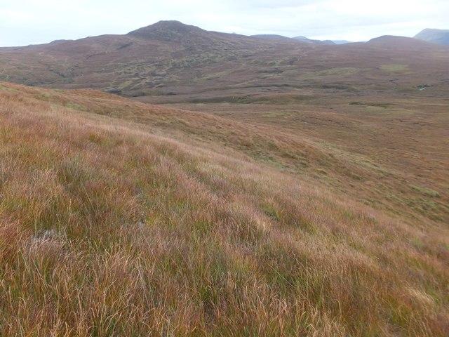 Grassy southern flank of Cnoc an t-Sìdhein