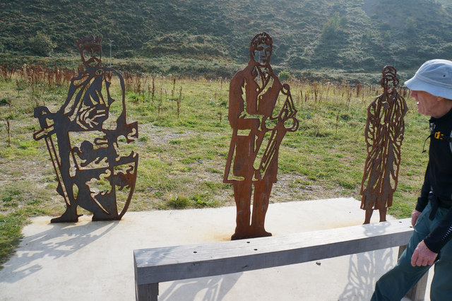 Sculptures of local people near Coney Morfa